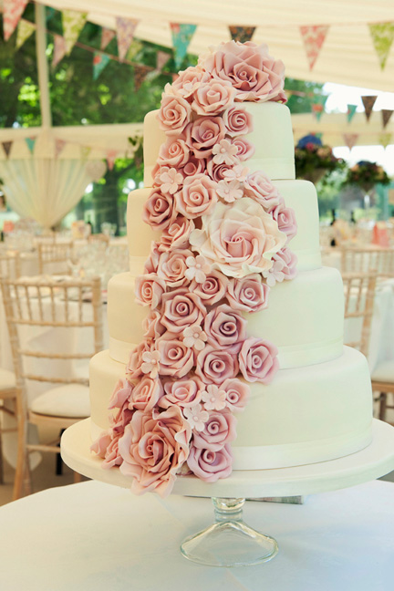4 Tier ivory wedding cake with roses