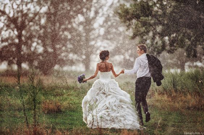 rain on your wedding day - bride and groom